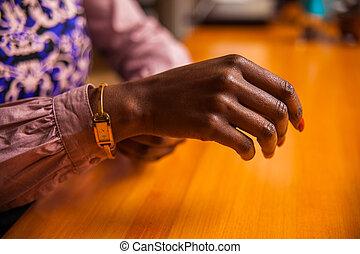 hands fastening watch around the wrist