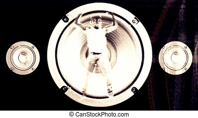 a young man inside a speaker cone, is forced around by the...