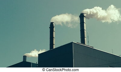 Factory Smokestacks - Fumes billowing out of smokestacks,...