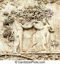 Adam and Eve, the original sin - marble relief on the...