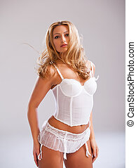 blonde woman wearing white lingerie