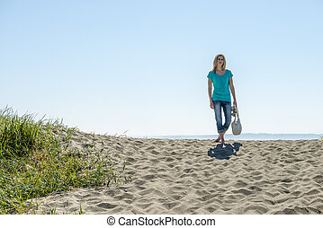Young Woman Standing On Beach - Young Woman Holding Handbag...