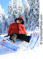 Young boy snowshoeing