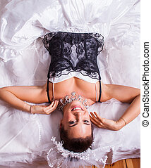 bride - woman in an extravagant wedding gown with black lace