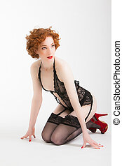 redhaired woman wearing black lingerie