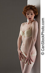 redhaired woman with light colored lingerie