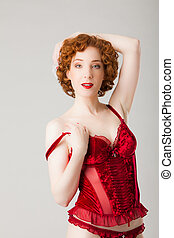 redhaired woman wearing red lingerie