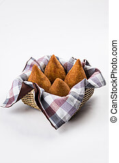 Brazilian Coxinha on a white background.