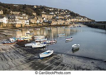 A traditional Cornish fishing village and harbor Cornwall...