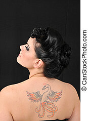 Eagle tat - Girl showing tattoo