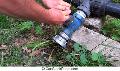 person opening a valve