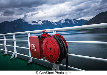 fire hose - red fire hose on a ship