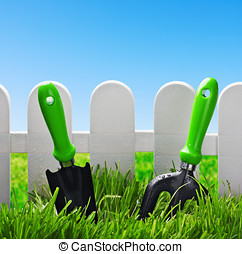 garden tools on a green lawn