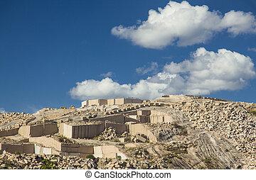 Granite Quarry - granite quarry under a blue sky with white...