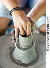 pottery making - female hands making pottery