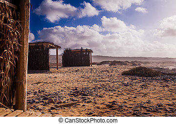 small huts at the beach