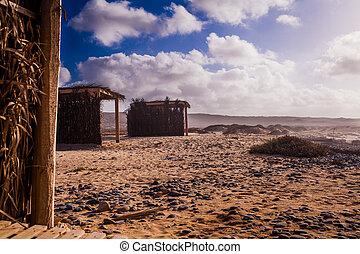 small huts at the beach