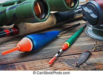 fishing tackle on a wooden table Focus on the float