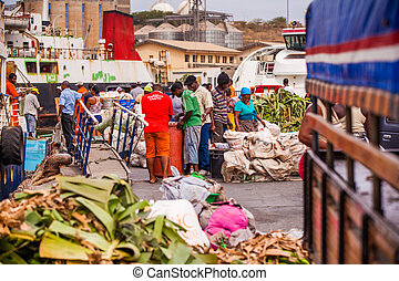 harbor - people stacking and selling goods at the harbor