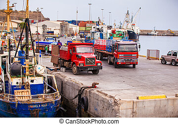harbor - two trucks at a harbor