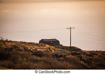 dawn - small house at the sea in the early morning hours