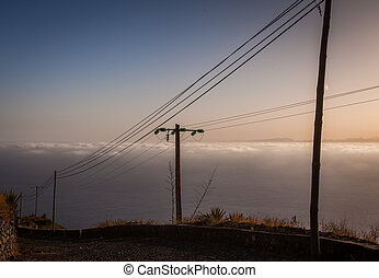 coastal road with electric and telephone cables