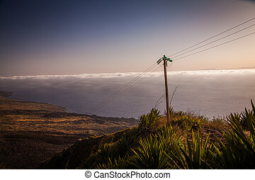 coast - pole standing at the coast with the sea in the...