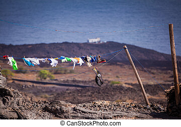 washing line - coastal landscape with clothes hanging on the...