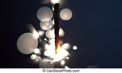 a sparkler being ignited making abstract pattern shot in super slow motion with the sony FS700 high speed camera