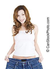Happy fit woman with big pants, showing how much weight she...