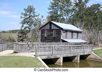 vintage gristmill dam - vintage dam and gristmill building...