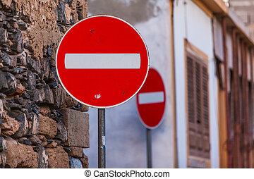 one-way street - red sign for an one-way street