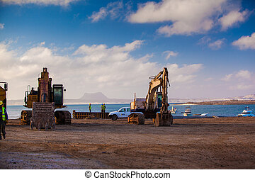 digger - excavator at the harbor