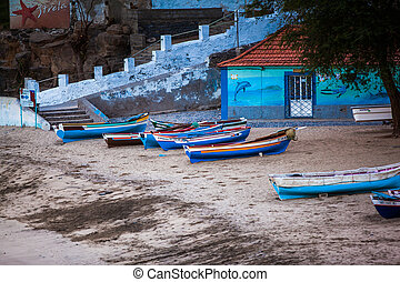 boats lying on the shore early in the morning