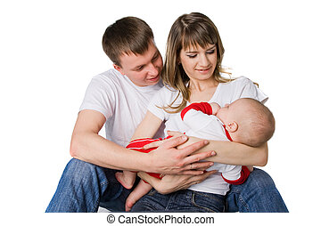Young mother and father holding their little child