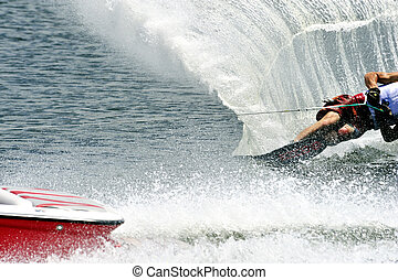 Water Ski In Action: Man Slalom - A man competitor in water...