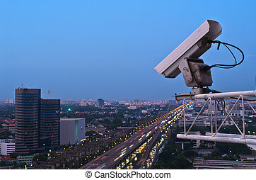 Security camera detects the movement of traffic. Skyscraper...