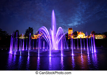 illuminated fountain at night in Warsaw Poland - Warsaw...