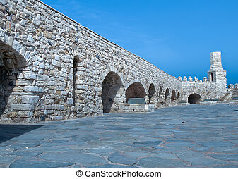 Loopholes of the old fortress. - Wall and battlements of the...