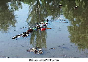 dirty river - debris floating in the muddy river