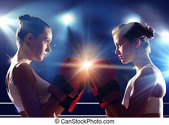 Two women boxing in ring - Two young pretty women boxing in...