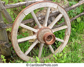 Wooden Wheel - Wooden Horse Carriage Wheel Leaned on a Fence