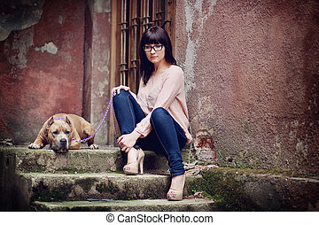 young woman wit the dog - young woman with her dog outdoors