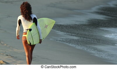 a cool surfer chick shot from behind in mexico