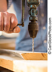 Man working hand drill