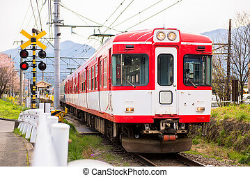 red train in rural site of Japan