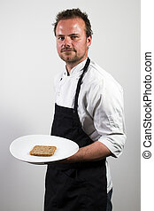 chef holding a plate with rye bread