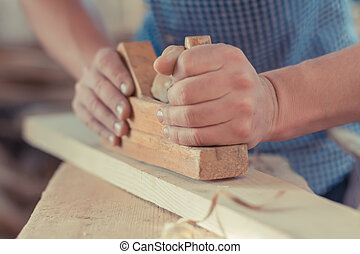 Hands working planer