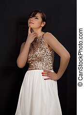 Beautiful young woman in white skirt reflecting
