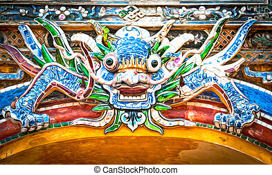 Dragon over gate to Hue citadel. Vietnam, Asia.